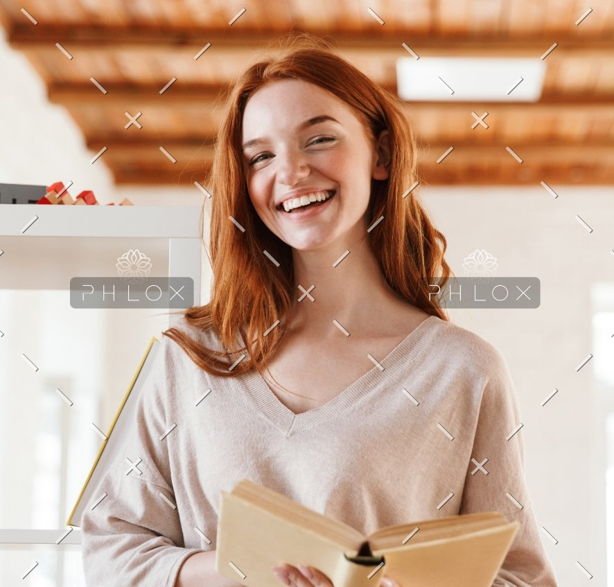happy-redhead-young-lady-student-reading-book-M5Z7RVC@2x-1